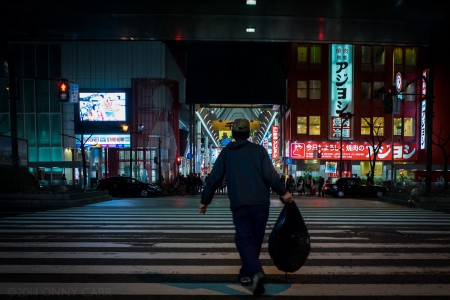 A man crossing the street in Osaka